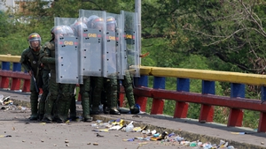 Security forces clash with protesters after an aid vehicle was blocked at the Francisco de Paula Santander Bridge in Tachira, Venezuela