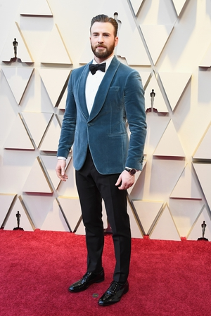 Chris Evans in Salvatore Ferragamo with an IWC watch and Montblanc jewelry.