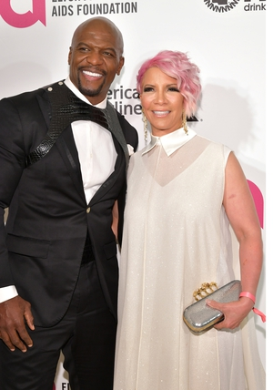 Terry Crews donned a patterned bib with a sleek black tuxedo