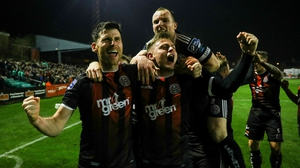 Bohemians players celebrate in front of supporters after Dinny Corcoran scored the only goal against Shamrock Rovers