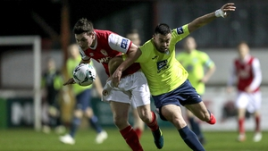 Kevin Toner and Nathan Boyle tussle for the ball in tonight's encounter in Inchicore