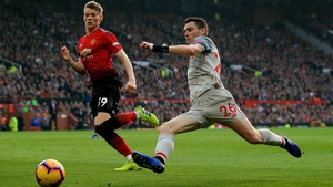 Andy Robertson (R) battles with Man Utd's Scott McTominay