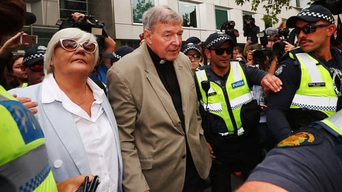 George Pell leaves the County Court of Victoria after reporting restrictions were lifted