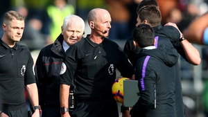 Mauricio Pochettino confronts referee Mike Dean at the final whistle