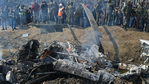 Soldiers and onlookers at the scene of a crashed Indian jet in Kashmir