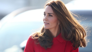 The Duchess of Cambridge chose a favourite red coat for today's event in Belfast.