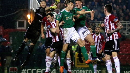 Cork City goalkeeper Mark McNulty attempts to clear