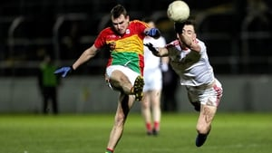 Fergal Donohoe of Louth attempts to block Carlow's Sean Gannon and