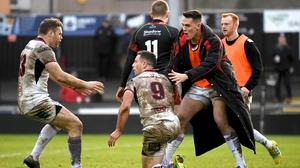 John Cooney celebrates his try