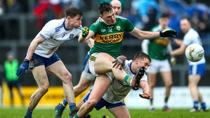 Kerry's Gavin O'Brien gets a shot away despite attentions of Karl O'Connell and Ryan Wylie