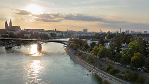 The Rhine and Basel in the evening light.  swiss-image.ch/Stefan Tschumi