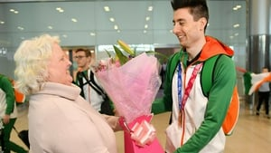 Mark English is greeted at the airport