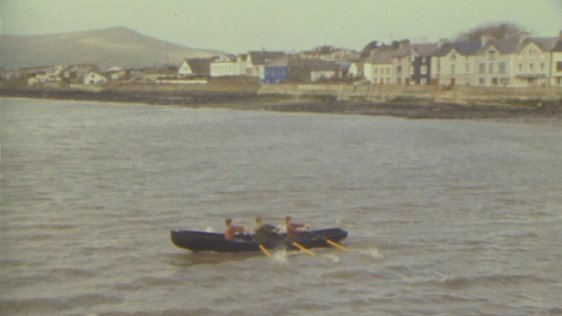 Eddie Hutchinson and sons rowing naomhóg in Dingle, County Kerry (1984)