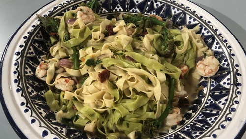 Prawn tagliatelle with purple sprouting broccoli & semi-sundried tomato.