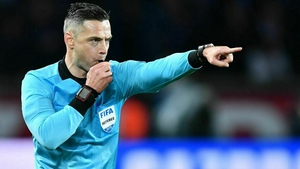 Referee Damir Skomina points at the penalty spot at Parc des Princes