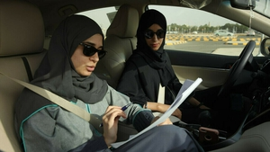 A student and instructor practice driving in Saudi Arabia