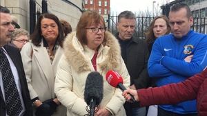 Briege Voyle, whose mother was shot dead in Ballymurphy, reacts outside Belfast Coroner's Court