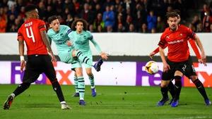 Mesut Ozil takes a shot