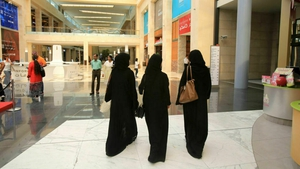 Saudi women wearing the veil and abaya