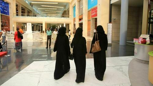 Saudi women wearing the veil and abaya