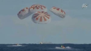 Live footage from NASA showed the capsule splashing down into the ocean