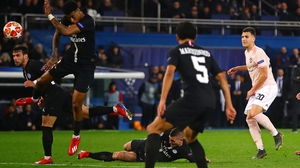 Presnel Kimpembe (far left_ was penalised for handball after  Diogo Dalot's shot clipped his arm