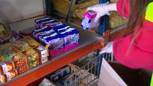 Sanitary towels being stacked at Crosscare food bank in Glasnevin