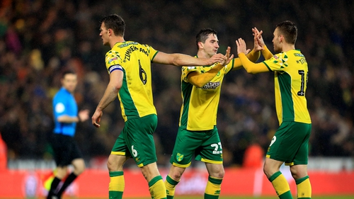 Norwich players celebrating at the final whistle.
