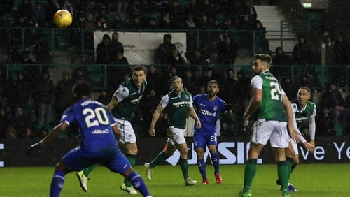 A fan leapt from the home end to confront Hibs skipper James Tavernier on the stroke of half-time