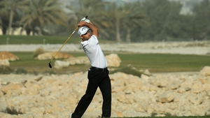 Oliver Wilson plays into the 18th green during the third round of the Qatar Masters