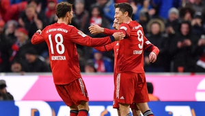 Robert Lewandowski celebrates his second goal with Leon Goretzka and Franck Ribery