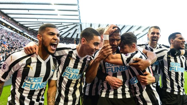 Newcastle players celebrate the winning goal