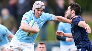 Rob Guerin barges past UCD's Paddy Patterson to take his try