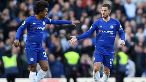 Eden Hazard of Chelsea is congratulated by team-mate Willian