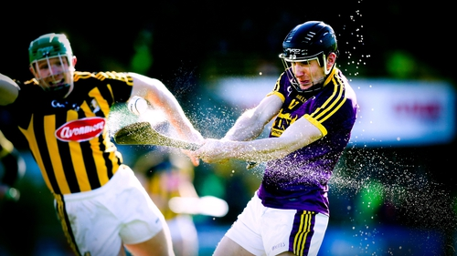Water sprays of Liam Óg McGovern's hurl as he shoots