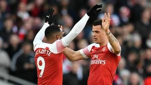 Granit Xhaka (R) joined Arsenal three years ago