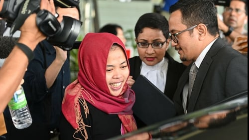 Indonesian woman Siti Aisyah smiles while leaving the court in Malaysia