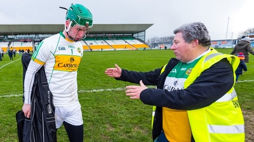 Offaly goalkeeper Eoghan Cahill is consoled by Offaly fan Mick McDonagh after the defeat to Carlow