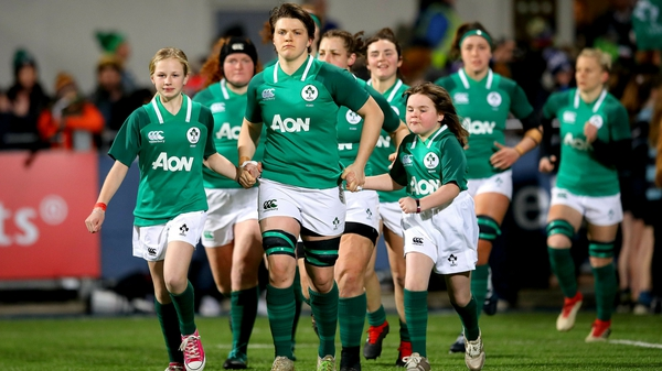 Ireland captain Ciara Griffin leads out he team against Frnace