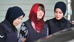 Doan Thi Huong (C) broke down in tears in court