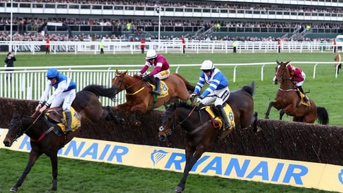 Bryony Frost on her way to victory in the Ryanair Chase on Frodon (l)