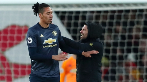 Gary Cooper, who confronted Smalling, has since been arrested and charged with common assault and encroaching on to the playing area