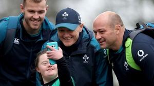 Will Addison (L), Joe Schmidt and Rory Best with Ireland fan Jennifer Malone