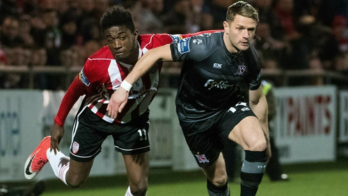 Derry City's Junior Ogedi-Uzokwe (L) tangles with Dane Massey