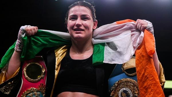 Katie Taylor with her three belts - the final piece of the collection may land in the summer