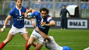 France's Yoann Huget is tackled at Stadio Olimpico