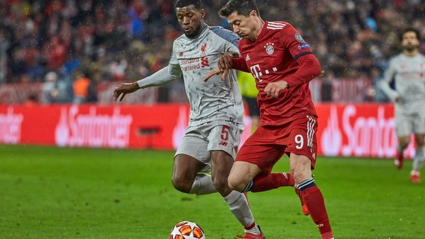 Georginio Wijnaldum (L) battles Robert Lewandowski of Bayern Munich