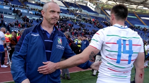Italy head coach Conor O'Shea consoles Edoardo Padovani after the game