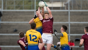 Gary O'Donnell and Tadhg O'Rourke challenge for the ball in the air