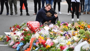 Members of the public mourn at a flower memorial near the Al Noor Mosque in Christchurch